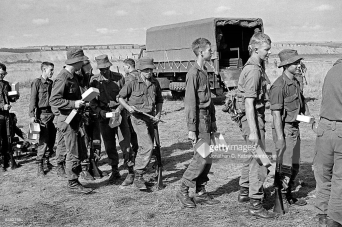 South African National Servicemen from Platoon 2, A Company, 7 SA Infantry Battalion (7SAI) of the South African Defence Force (SADF) line up for food with their dixies during their basic training in 1974.